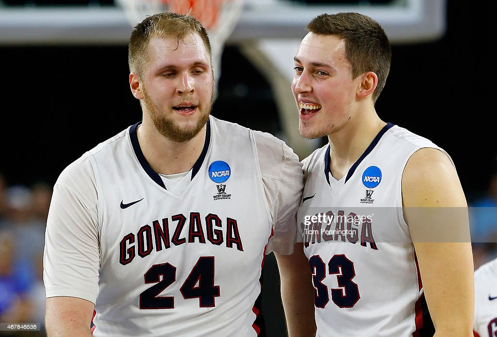 Przemek Karnowski #24 celebrates with <a gi-track='captionPersonalityLinkClicked' href=/galleries/search?phrase=Kyle+Wiltjer&family=editorial&specificpeople=7621176 ng-click='$event.stopPropagation()'>Kyle Wiltjer</a> #33 of the Gonzaga Bulldogs against the UCLA Bruins during a South Regional Semifinal game of the 2015 NCAA Men's Basketball Tournament at NRG Stadium on March 27, 2015 in Houston, Texas.