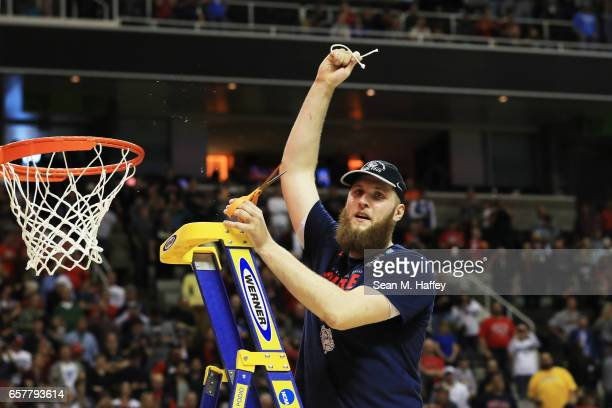 Przemek Karnowski of the Gonzaga Bulldogs cuts down the net after their 83 to 59 win over the Xavier Musketeers during the 2017 NCAA Men's Basketball...