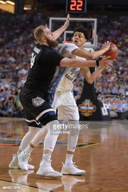 Przemek Karnowski of the Gonzaga Bulldogs defends Justin Jackson of the North Carolina Tar Heels during the 2017 NCAA Men's Final Four Championship...