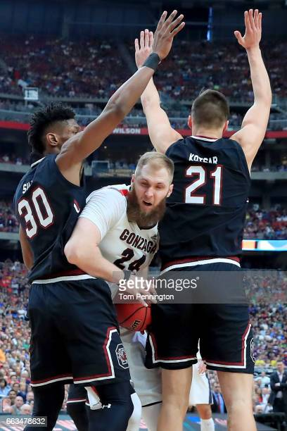 Przemek Karnowski of the Gonzaga Bulldogs handles the ball against Chris Silva and Maik Kotsar of the South Carolina Gamecocks in the first half...