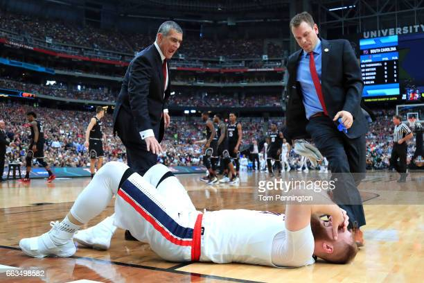 Przemek Karnowski of the Gonzaga Bulldogs lies on the floor after a collision in the first half against the South Carolina Gamecocks during the 2017...