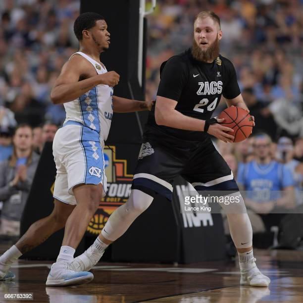 Przemek Karnowski of the Gonzaga Bulldogs moves the ball against Kennedy Meeks of the North Carolina Tar Heels during the 2017 NCAA Men's Final Four...