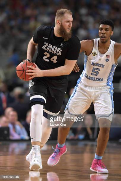 Przemek Karnowski of the Gonzaga Bulldogs moves the ball against Tony Bradley of the North Carolina Tar Heels during the 2017 NCAA Men's Final Four...