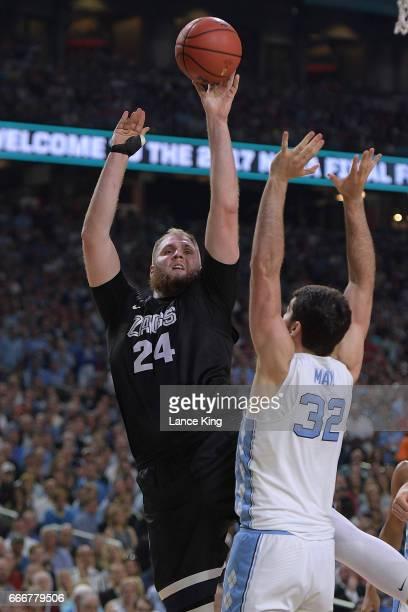Przemek Karnowski of the Gonzaga Bulldogs puts up a shot against Luke Maye of the North Carolina Tar Heels during the 2017 NCAA Men's Final Four...
