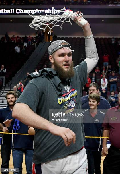 Przemek Karnowski of the Gonzaga Bulldogs reacts after cutting down a net following the team's 7456 victory over the Saint Mary's Gaels to win the...
