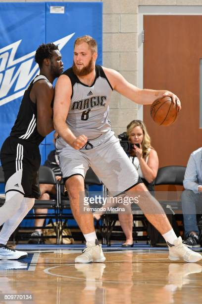 Przemek Karnowski of the Orlando Magic drives to the basket against the Charlotte Hornets during the Mountain Dew Orlando Pro Summer League on July 6...
