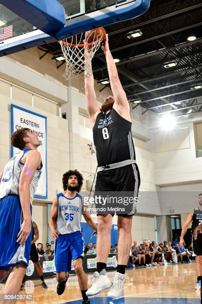 Przemek Karnowski of the Orlando Magic dunks the ball during the game against the New York Knicks during the 2017 Orlando Summer League on July 5...