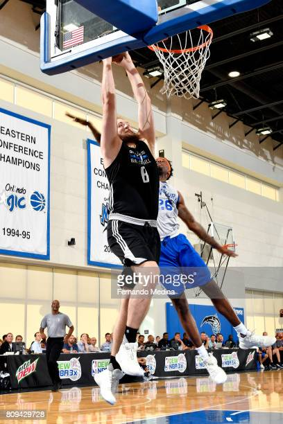 Przemek Karnowski of the Orlando Magic goes for a dunk during the game against the New York Knicks during the 2017 Orlando Summer League on July 5...
