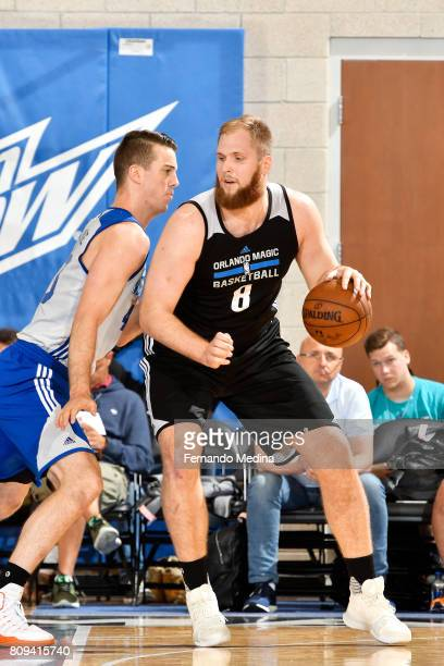Przemek Karnowski of the Orlando Magic handles the ball during the game against the New York Knicks during the 2017 Orlando Summer League on July 5...