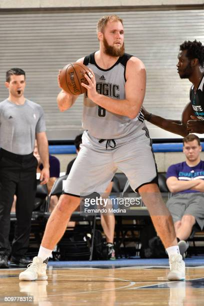 Przemek Karnowski of the Orlando Magic looks to drive to the basket against the Charlotte Hornets during the Mountain Dew Orlando Pro Summer League...