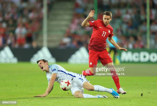 Przemyslaw Frankowski of Poland fouls Ben Chilwell of England during the UEFA European Under21 Championship Group A match between England and Poland...