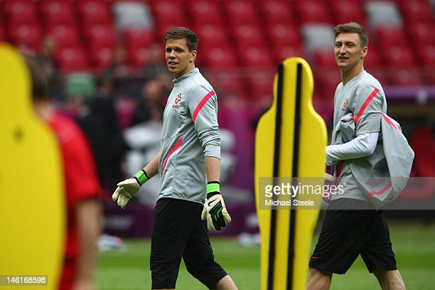 Przemyslaw Tytori and Wojciech Szczesny of Poland during a UEFA EURO 2012 training session at the National Stadium on June 11 2012 in Warsaw Poland