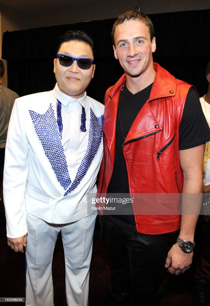 Psy and Ryan Lochte backstage during the 2012 iHeartRadio Music Festival at MGM Grand Garden Arena on September 21, 2012 in Las Vegas, Nevada.