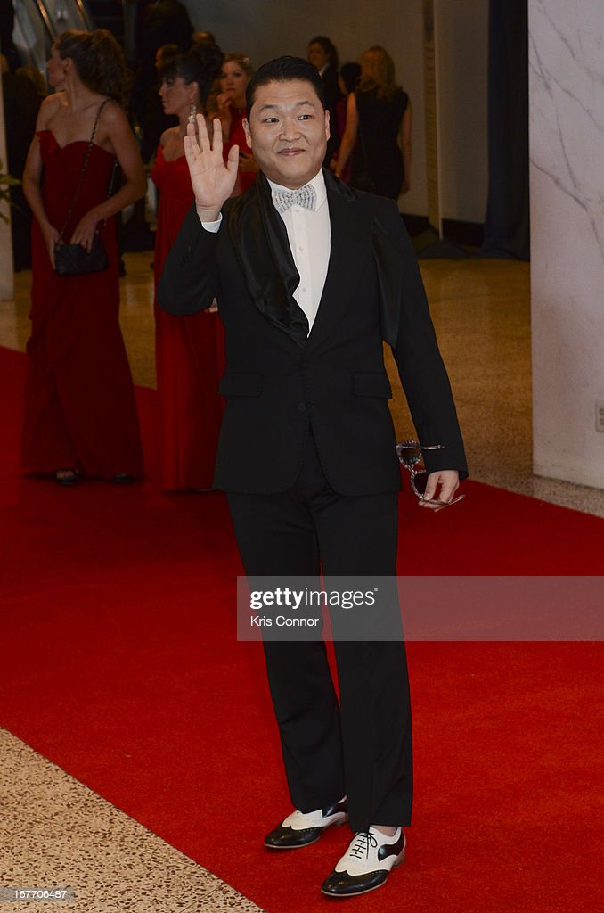 Psy poses on the red carpet during the White House Correspondents' Association Dinner at the Washington Hilton on April 27, 2013 in Washington, DC.