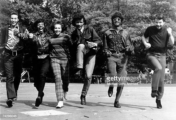 Psychedelic soul group 'Sly The Family Stone' run toward the camera for a portrait in 1968 Gregg Errico Freddie Stone Cynthia Robinson Sly Stone...
