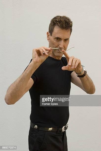 Psychic Uri Geller bending a spoon