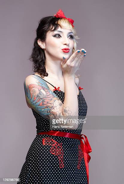 Psychobilly girl blowing kiss