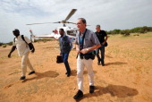 A psychologist arrives with Burkinabe Lebanese and French representatives of the victims' families at the crash site of the Air Algerie flight AH5017...