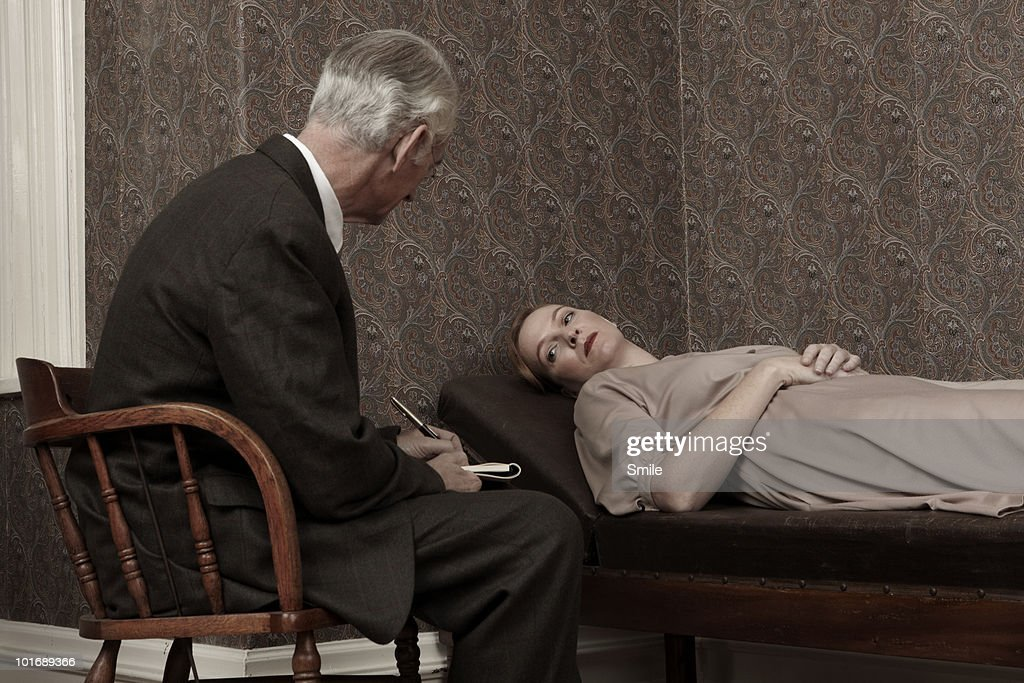 Psychologist listening to female patient : Stock Photo