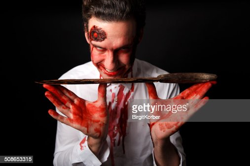 Psychopath with bloody knife : Stock Photo