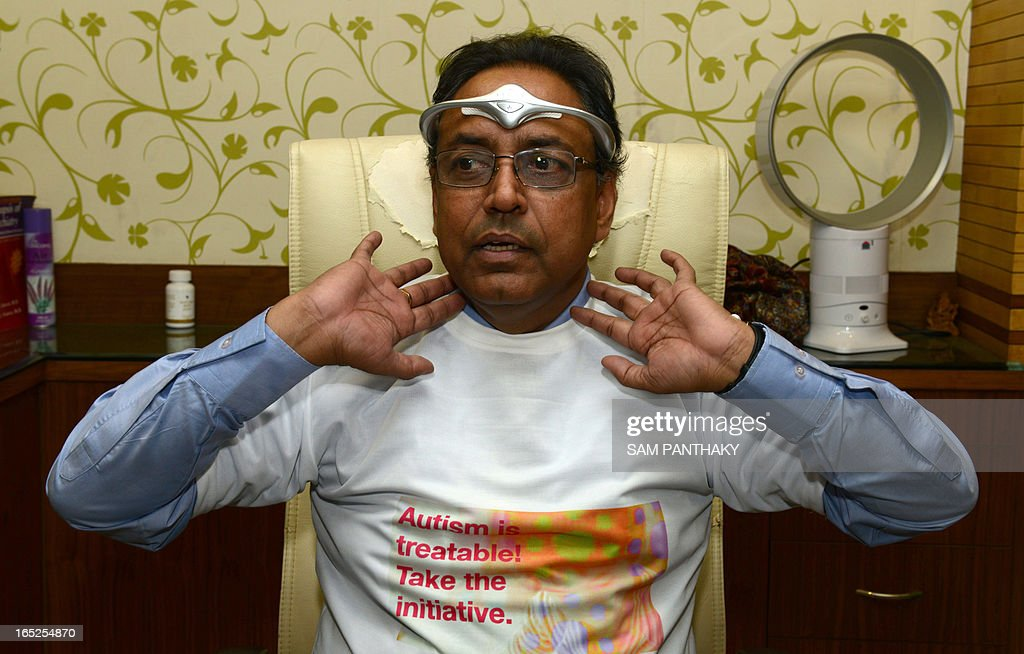 Psychotherapist and Neuro-Psychiatrist Vinod Kumar Goyal wears a Trans-Cranial Magnetic Stimulator which helps to increase blood supply to the brain, on his forehead during the celebration of World Autism Day in Ahmedabad on April 2, 2013. Autism patients with their parents and Autism Awareness Campaign volunteers celebrated World Autism Day at Psychotherapist and Neuro-Psychiatrist Vinod Kumar Goyal's Parth Hospital in Ahmedabad. Autism is a disorder of neural development characterized by impaired social interaction and communication, and by restricted and repetitive behavior. AFP PHOTO / Sam PANTHAKY