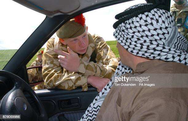 Pte James Jones from Dunfermline a member of the 1st Battalion The Black Watch checks a driver of a car during a training exercise on Salisbury Plain...