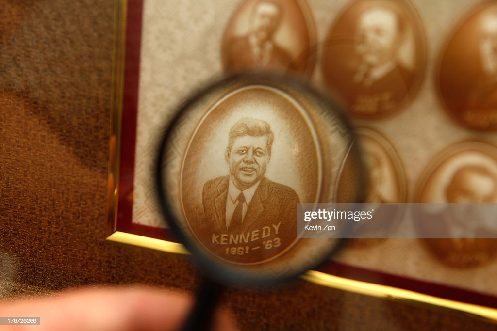 Pu Derong looks through a magnifying glass to see an egg with John Kennedy carved, on July 1, 2013 in Zhuozhou, Hebei Provience, China. Egg carving, an art form originated in the Ming and Qing Dynasties has grown in popularity recently. Pu Derong, from Zhuozhou City, Hebei Province has carved eggs since 1995, and after becoming recognised for his work he now works for museums to carve for them.