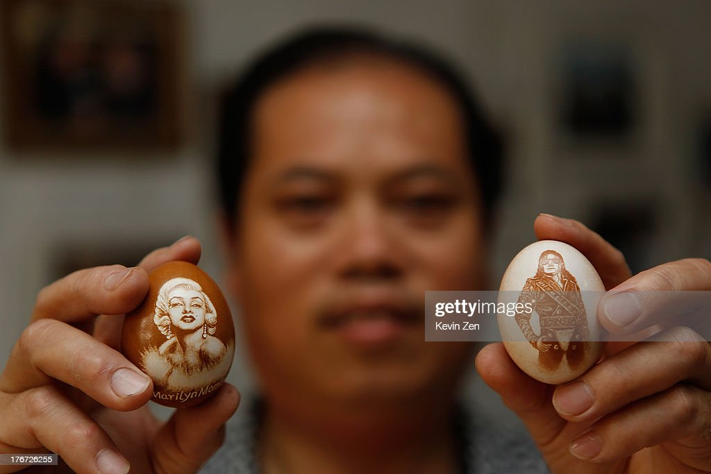 Pu Derong show his works on eggshell, on which he carved portraits of Madonna and Miceal Jackson on July 1, 2013 in Zhuozhou, Hebei Provience, China. Egg carving, an art form originated in the Ming and Qing Dynasties has grown in popularity recently. Pu Derong, from Zhuozhou City, Hebei Province has carved eggs since 1995, and after becoming recognised for his work he now works for museums to carve for them.