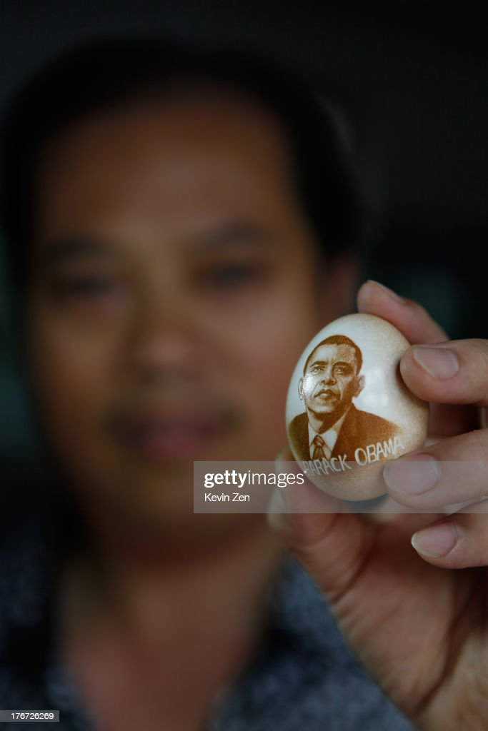 Pu Derong shows his work on eggshell, on which he carved a portrait of <a gi-track='captionPersonalityLinkClicked' href=/galleries/search?phrase=Barack+Obama&family=editorial&specificpeople=203260 ng-click='$event.stopPropagation()'>Barack Obama</a> on July 1, 2013 in Zhuozhou, Hebei Provience, China. Egg carving, an art form originated in the Ming and Qing Dynasties has grown in popularity recently. Pu Derong, from Zhuozhou City, Hebei Province has carved eggs since 1995, and after becoming recognised for his work he now works for museums to carve for them.