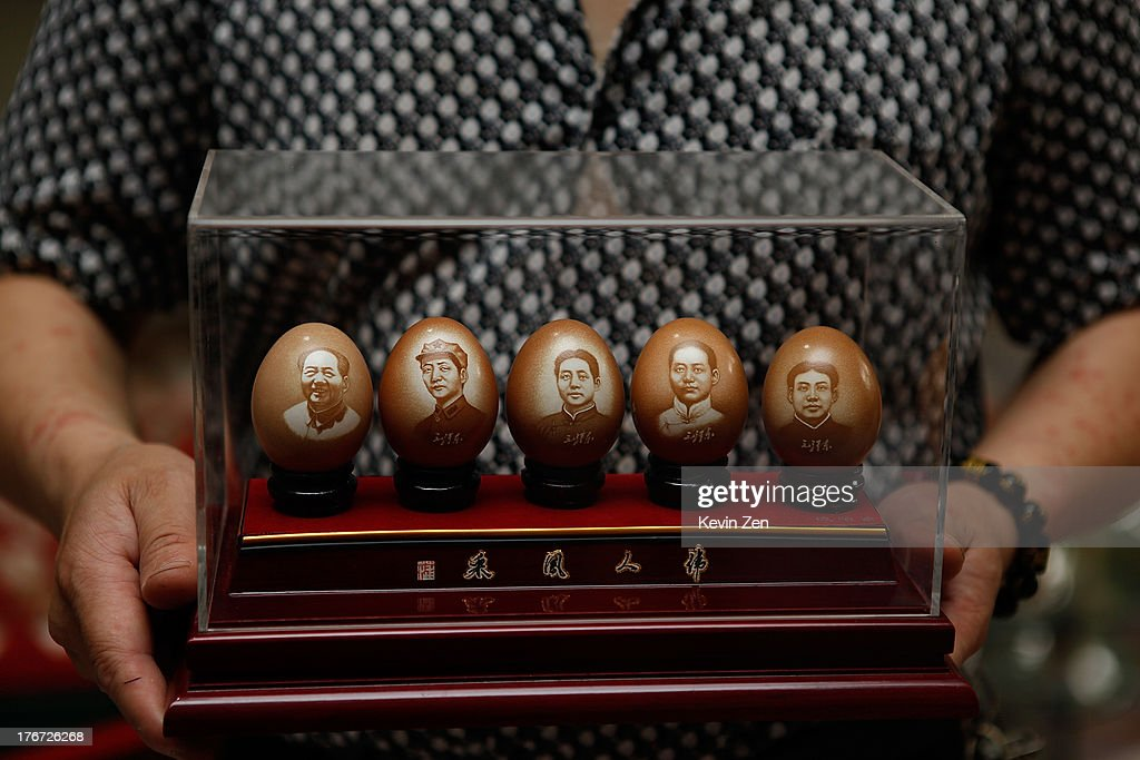 Pu Derong shows one of his works, which covers five periods of Mao Zedong, on July 1, 2013 in Zhuozhou, Hebei Provience, China. Egg carving, an art form originated in the Ming and Qing Dynasties has grown in popularity recently. Pu Derong, from Zhuozhou City, Hebei Province has carved eggs since 1995, and after becoming recognised for his work he now works for museums to carve for them.