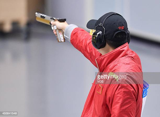 Pu QiFeng of China competes in Men's Shooting 10m Air Pistol during day two of the 2014 Asian Games at Dream Park Stadium on September 21 2014 in...