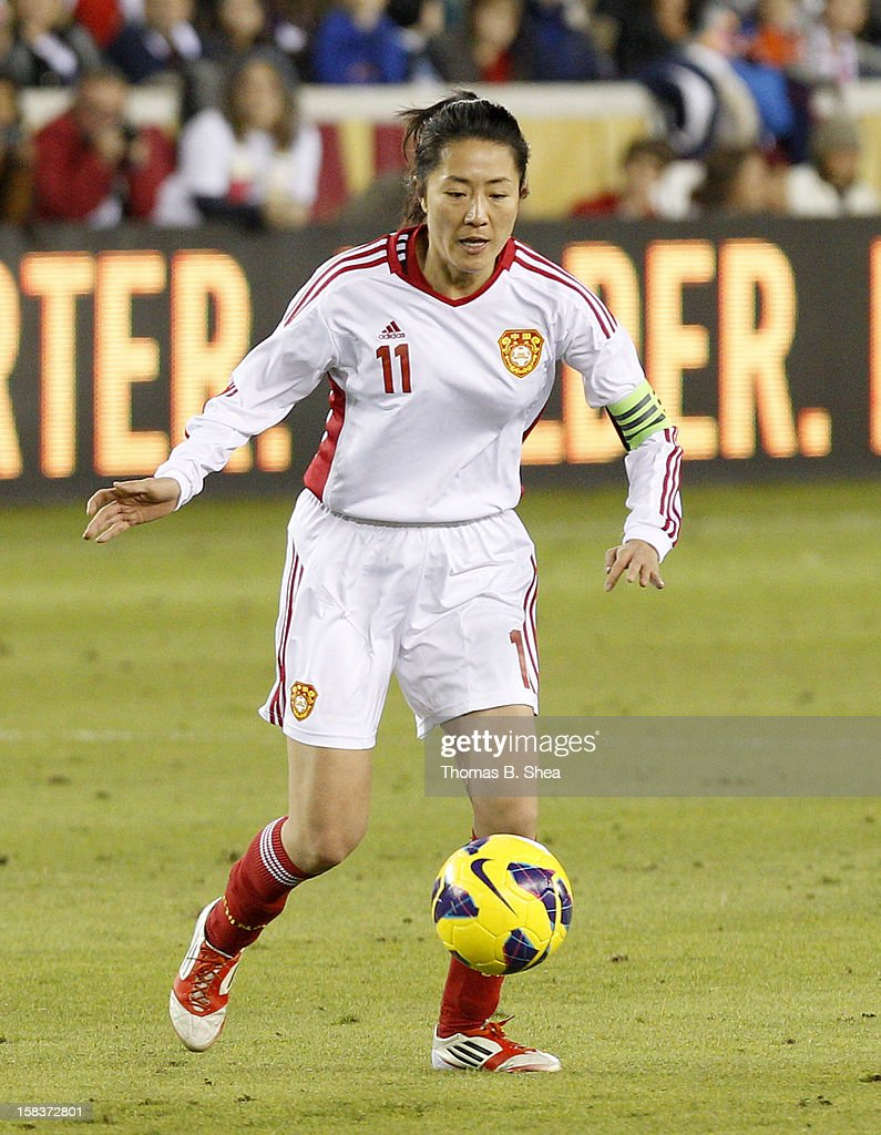 Pu Wei midfielder #11 of the China Women's National Team dribbles the ball against the U.S. Women's National Team in an international friendly game at BBVA Compass Stadium on December 12, 2012 in Houston, Texas. USA won 4 to 0.