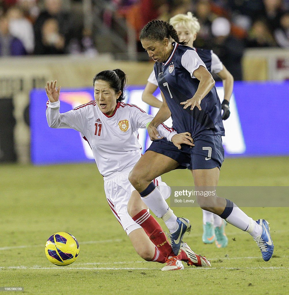 Pu Wei (11) of China holds off Shannon Boxx (7) of the United States in the second half at BBVA Compass Stadium on December 12, 2012 in Houston, Texas. USA won 4-0.