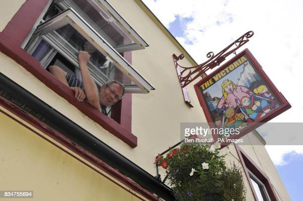 Pub owner Peter GowerCrane stands inside his pub The Victoria in St Werburghs Bristol which has caused controversy by swapping a sign of Queen...