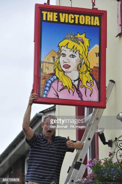 Pub owner Peter GowerCrane stands outside his pub The Victoria in St Werburghs Bristol which has caused controversy by swapping a sign of Queen...