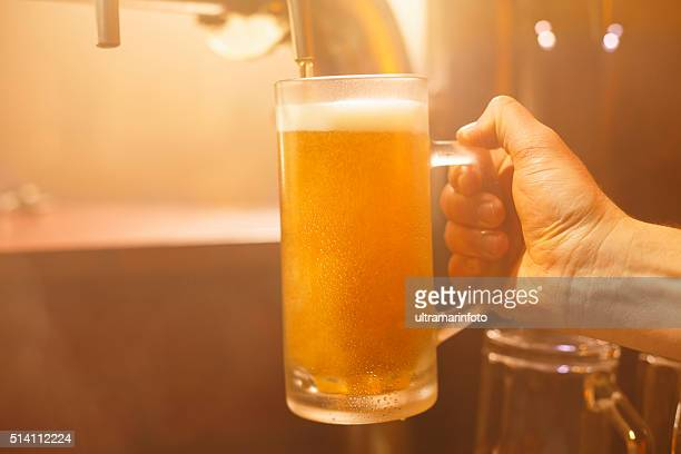 Pub Pouring a glass of  beer