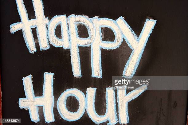 Pub sign saying 'Happy Hour'.