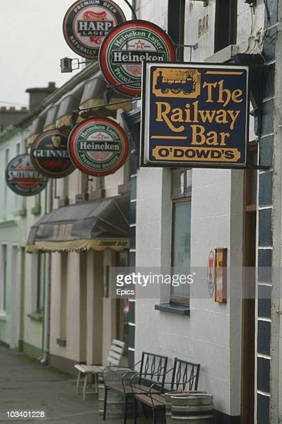 Pub Signs advertising Guinness Heineken Harp and 'O'Dowd's Railway Bar' in County Leitrim Ireland circa 1980