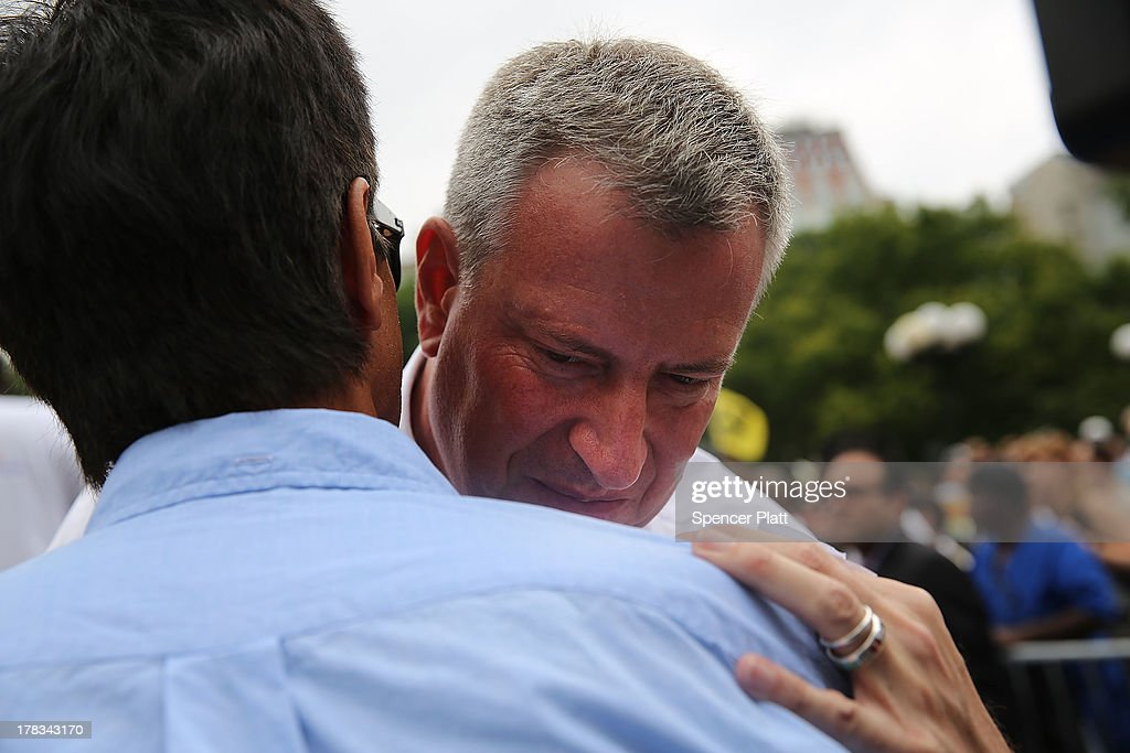 Public Advocate and mayoral candidate Bill de Blasio speaks to an aide in Union Square while showing support for demonstrating fast food workers on August 29, 2013 in New York City. Across the country thousands of low-wage workers are expected to walk off their jobs Thursday at fast food establishments in several U.S. cities. Workers at KFC, Wendy's, Burger King, McDonald's and other restaurants are calling for a living wage of $15 an hour and the right to form a union without retaliation. In a poll released Wednesday by Quinnipiac University, de Blasio is now close to the 40 percent threshold he'd need to avoid a runoff in the Democratic primary.
