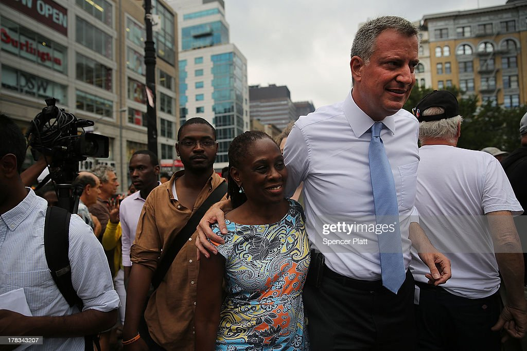 Public Advocate and mayoral candidate Bill de Blasio walks with his wife Chirlane McCray after making an appearance in Union Square in support of demonstrating fast food workers on August 29, 2013 in New York City. Across the country thousands of low-wage workers are expected to walk off their jobs Thursday at fast food establishments in several U.S. cities. Workers at KFC, Wendy's, Burger King, McDonald's and other restaurants are calling for a living wage of $15 an hour and the right to form a union without retaliation. In a poll released Wednesday by Quinnipiac University, de Blasio is now close to the 40 percent threshold he'd need to avoid a runoff in the Democratic primary.
