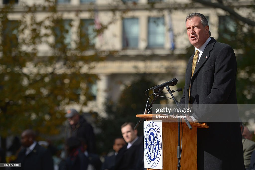 Public Advocate/ Mayor-elect <a gi-track='captionPersonalityLinkClicked' href=/galleries/search?phrase=Bill+de+Blasio&family=editorial&specificpeople=6224514 ng-click='$event.stopPropagation()'>Bill de Blasio</a> addresses the audience during the 94th annual New York City Veterans Day Parade on 5th Avenue on November 11, 2013 in New York City. The parade is the largest of its kind in the country and this year is especially dedicated to women serving in the armed forces.