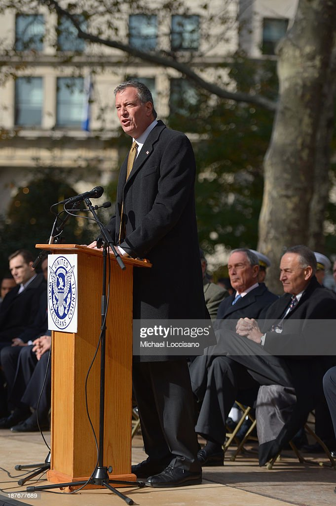 Public Advocate/Mayor-elect <a gi-track='captionPersonalityLinkClicked' href=/galleries/search?phrase=Bill+de+Blasio&family=editorial&specificpeople=6224514 ng-click='$event.stopPropagation()'>Bill de Blasio</a> addresses the audience during the 94th annual New York City Veterans Day Parade on 5th Avenue on November 11, 2013 in New York City. The parade is the largest of its kind in the country and this year is especially dedicated to women serving in the armed forces.