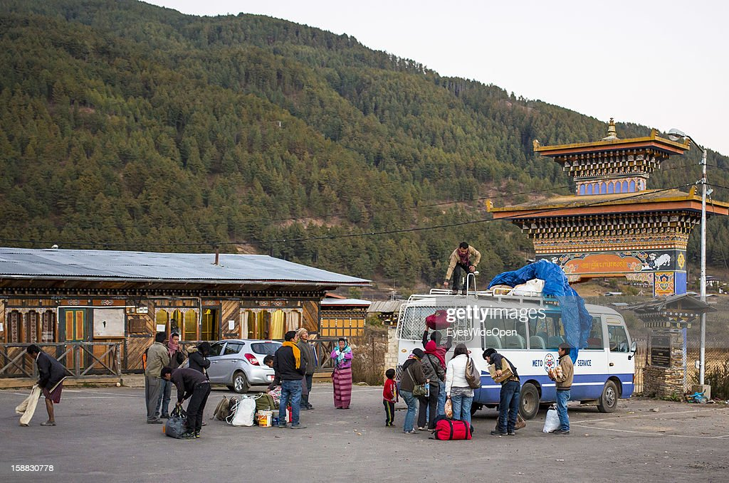 Public bus arrival with local passengers and baggage on November 18, 2012 in Bumthang, Bhutan.