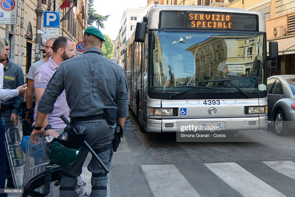 ATAC public buses used to take refugees away on August 19, 2017 in Rome, Italy. Police evict approx 500 Eritrean and Somali refugees form an occupied building in Piazza Indipendenza.
