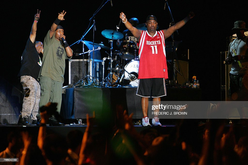 Public Enemy acknowledge the crowd after performing onstage in Beijing, 08 September 2007, with frontman Chuck D wearing a Houston Rockets Yao Ming jersey (#11). Some of the most subversive and hard-hitting rock and rap acts ever to play in China headlined the Beijing Pop Festival which opened amid signs Communist censors may be loosening up, but security remained tight to control the crowd's enthusiasm. Featured only as 'PE' in Chinese promotional materials due to the subversive nature of the band's full name, Public Enemy brought the house down by teaming up with Marky Ramone and Cui Jian on the Ramones classic hit 'Blitzkreig Bop.' AFP PHOTO/Frederic J. BROWN