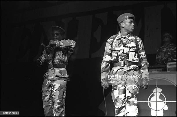 Public Enemy perform on stage at Hammersmith Odeon London 2nd November 1987 Professor Griff and Terminator X in right background