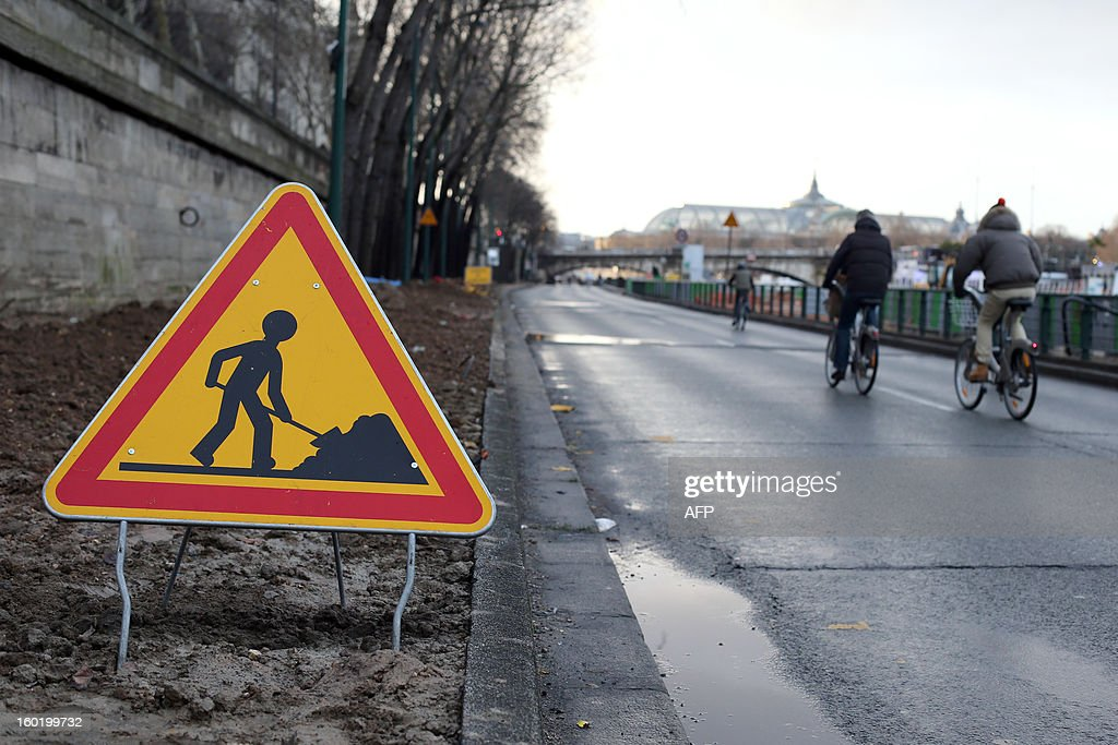 A public engineering work sign is pictured on the express road way next to the river Seine on January 27, 2013 in the center of Paris. This express way will be closed on January 28 for construction work.