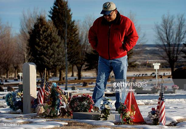 Public Health Administrator and former Council Chairman Selwyn Whiteskunk visits the grave of his brother Avery in Cortez CO Avery was murdered in...