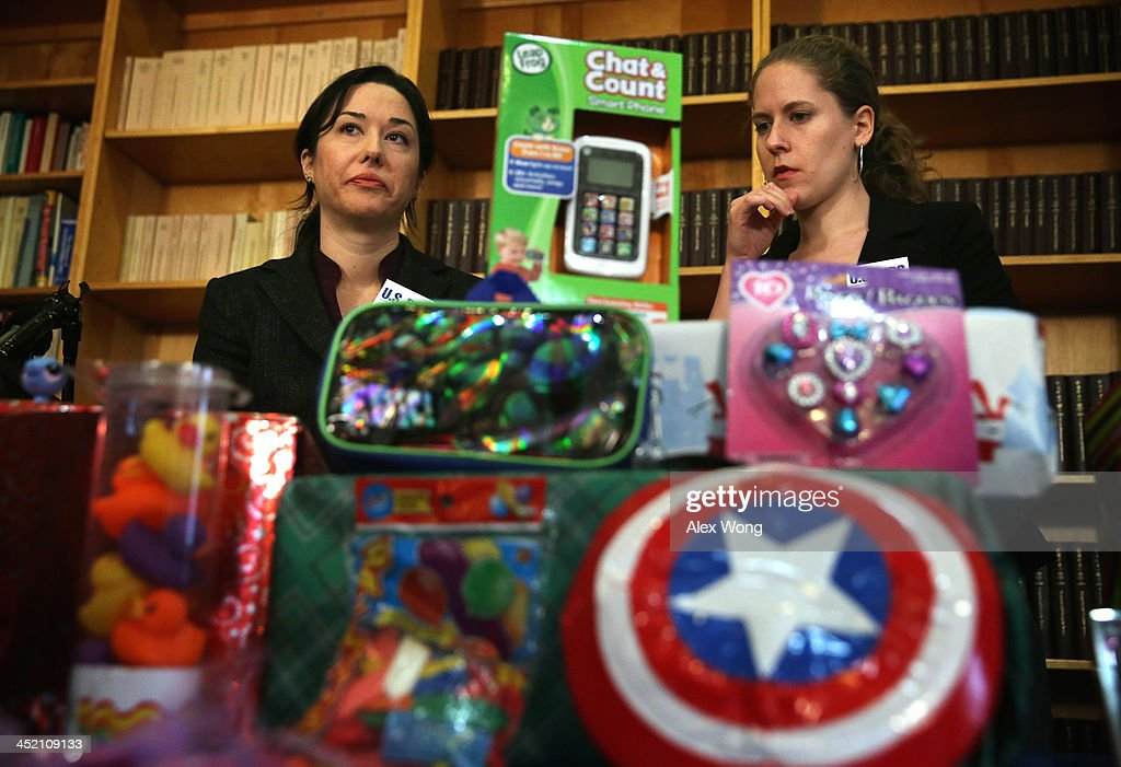 Public Health Advocate Jenny Levin (L) and consumer associate Laura Murray participate in a news conference on dangerous toys November 26, 2013 in Washington, DC. United States Public Interest Research Group (U.S. PIRG) released its 28th annual Trouble in Toyland report and list of dangerous toys to avoid this holiday season.