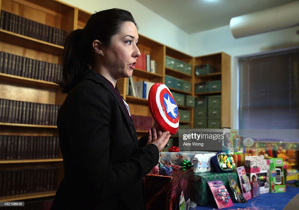 Public Health Advocate Jenny Levin holds up a Captain America Soft Shield, which contains lead 29 times over the federal standard, as she speaks to members of the media on dangerous toys November 26, 2013 in Washington, DC. United States Public Interest Research Group (U.S. PIRG) released its 28th annual Trouble in Toyland report and list of dangerous toys to avoid this holiday season.